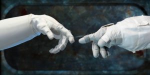 """2012 - NASA - Robonaut and EMU spacesuit-gloved hands are extended toward each other to demonstrate the collaboration between robots and humans in space in the style of Michelangelo's Sistine Chapel fresco titled """"The Creation of Adam""""."""